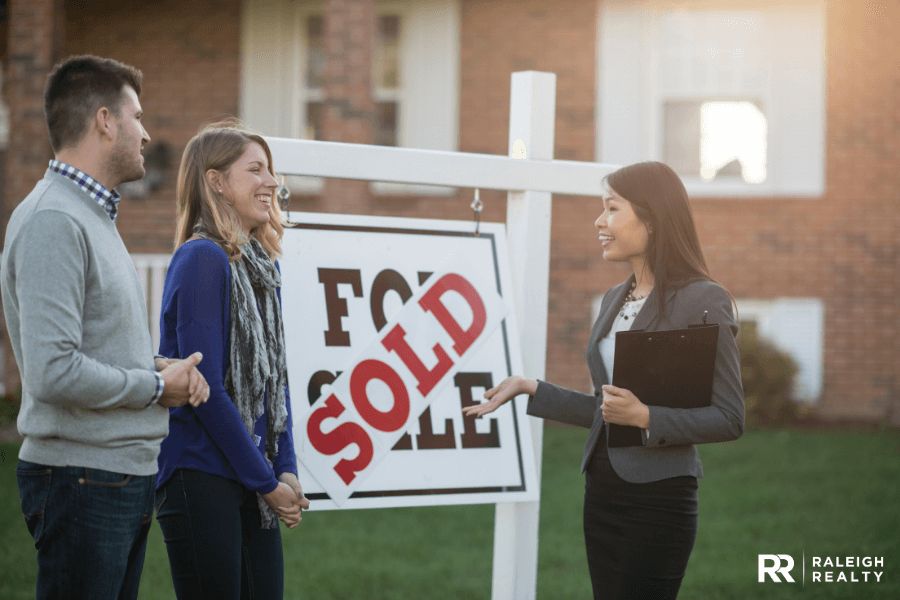 Real Estate Agent helping home buyers purchase their first home with success
